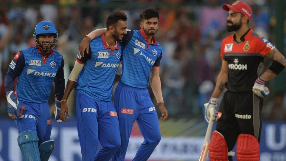 Delhi Capitals bowler Axar Patel (C) celebrates with his team captain Shreyas Iyer (R) and wicketkeeper Rishabh Pant (L). (AFP)