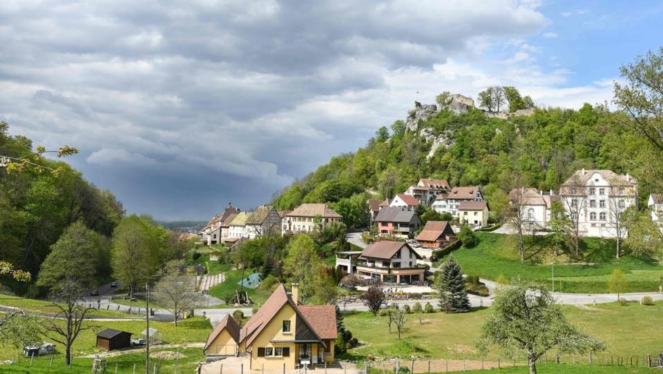 In the hilltop town of Ferrette near the border with Switzerland, few would expect to encounter Eritreans exploring the ruins of its medieval chateau or Chechens walking its steep narrow streets. But this tiny town in eastern France has opened its doors to asylum seekers who now represent some 10% of the population. (Sebastien Bozon / AFP)