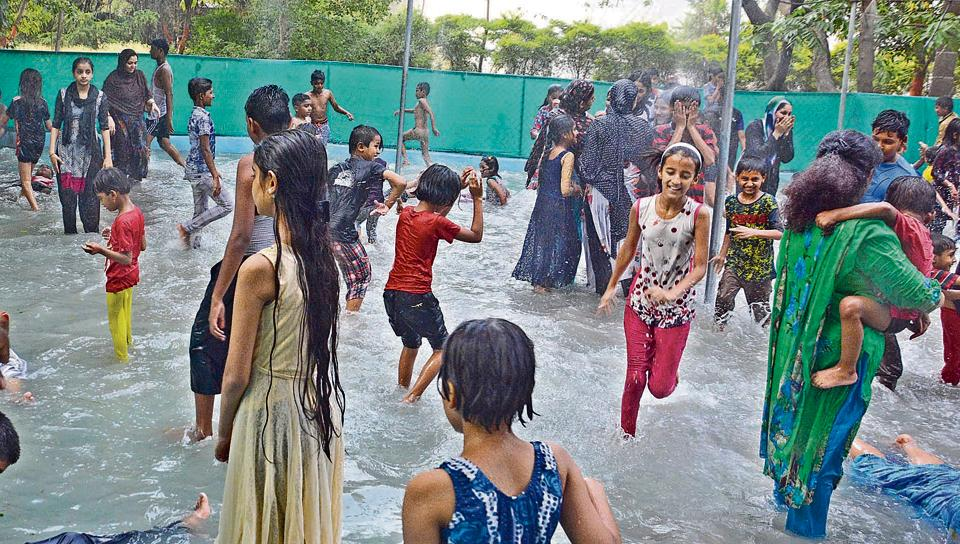 The city recorded a maximum temperature of 43 degrees celsius and children are seen playing at the Empress Garden on Sunday.