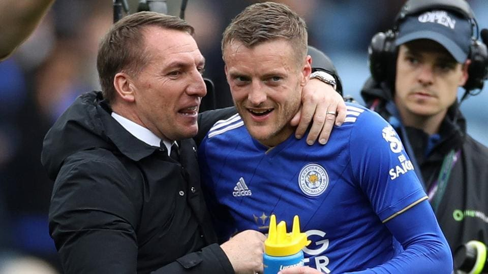 Leicester City manager Brendan Rodgers and Leicester City's Jamie Vardy celebrate after the match .