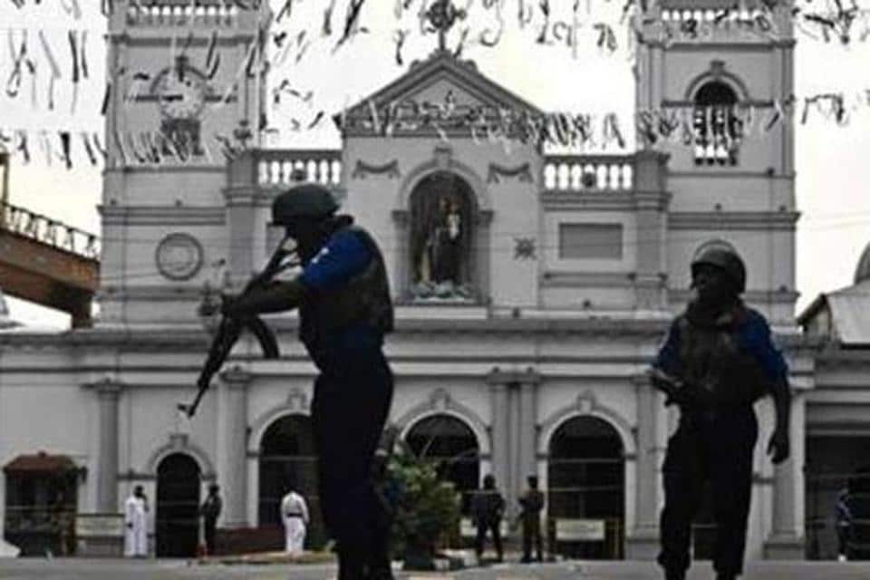 Security personnel stand guard in front of St. Anthony's Shrine in Colombo on April 23, 2019, two days after a series of bomb blasts targeting churches and luxury hotels in Sri Lanka.