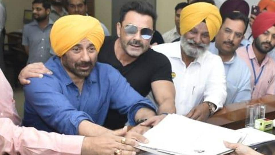 BJP candidate from Gurdaspur Sunny Deol, accompanied by his brother Bobby Deol, submits his nomination papers on Monday.