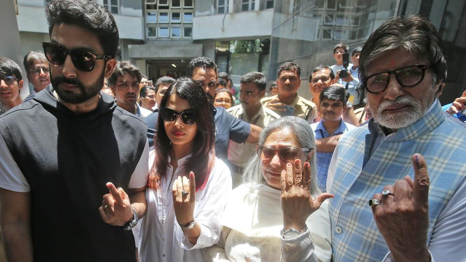 Bollywood star Amitabh Bachchan, son Abhishek Bachchan, Aishwarya Rai Bachchan and Jaya Bachchan show ink marks on their fingers after casting their votes at a polling station in Mumbai.