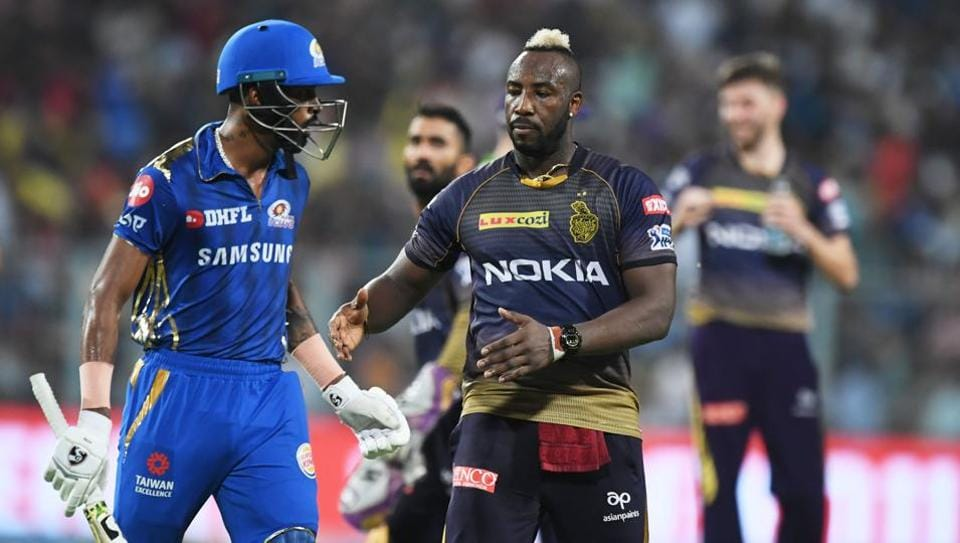 Kolkata Knight Riders' cricketer Andre Russell (C) congratulates Mumbai Indians' cricketer Hardik Pandya (L) for his innings after Pandya lost his wicket during the 2019 Indian Premier League (IPL)