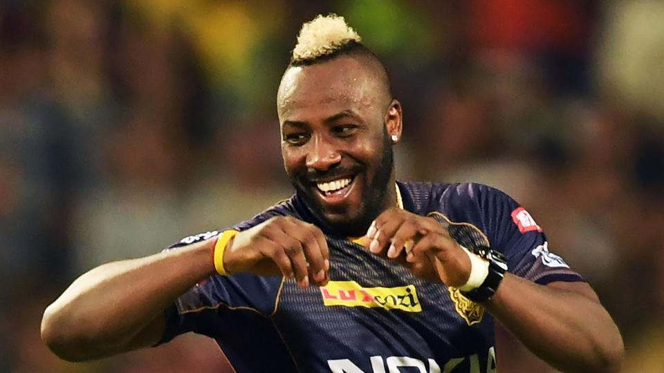 Kolkata Knight Riders' cricketer Andre Russell celebrates after taking the wicket of Mumbai Indias' cricketer Evin Lewis during the 2019 Indian Premier League (IPL) Twenty 20 cricket match between Kolkata Knight Riders and Mumbai Indians at the Eden Gardens Cricket Stadium, in Kolkata.