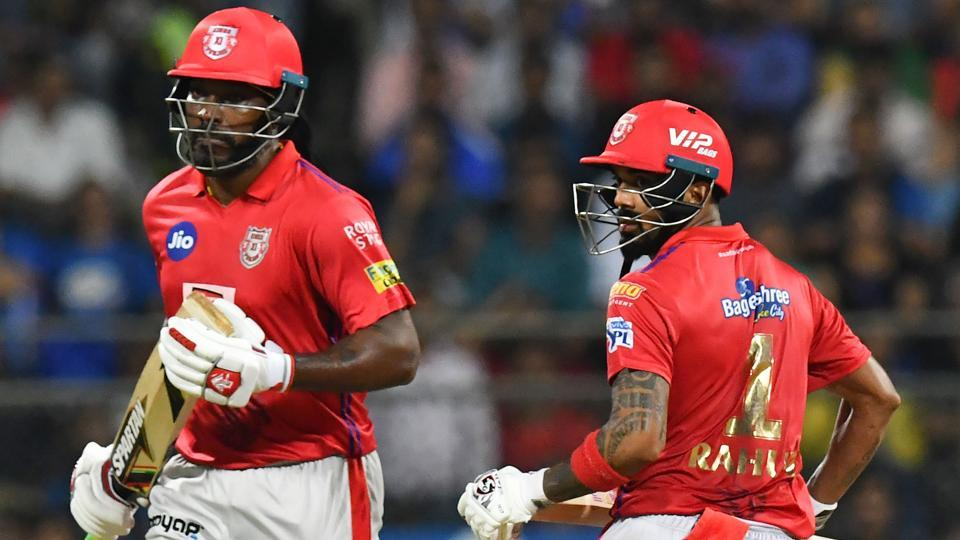 Kings XI Punjab cricketers Chris Gayle (L) and Lokesh Rahul run between the wickets during the 2019 Indian Premier League (IPL) Twenty20 cricket match between Mumbai Indians and Kings XI Punjab at the Wankhede cricket stadium in Mumbai on April 10, 2019.