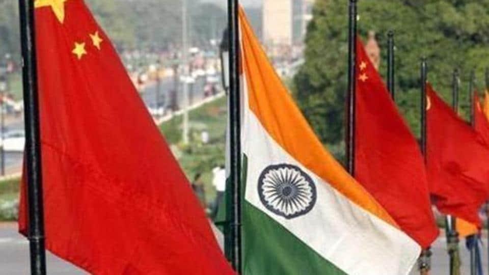 The flags of India and China at Vijay Chowk in New Delhi.