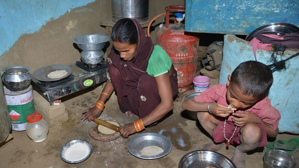 """Reena Devi felt her life change when she got a cooking gas connection under the billion-dollar programme, meaning she no longer had to cook with wood or coal and breathe in smelly, toxic fumes. But Devi said she had to pay ₹3,000 for the """"free"""" kit -- the equivalent of a month's wages for most people in her village Nisarpura, in Bihar. (Narinder Nanu / AFP)"""