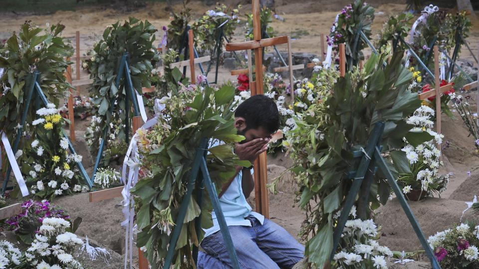 A Sri Lankan relative of a victim of Easter Sunday bomb blasts pays tribute at the burial site. Indian intelligence agencies are investigating if  the Sri Lankan bombers had any link with radical elements in south India, and Kerala in particular.