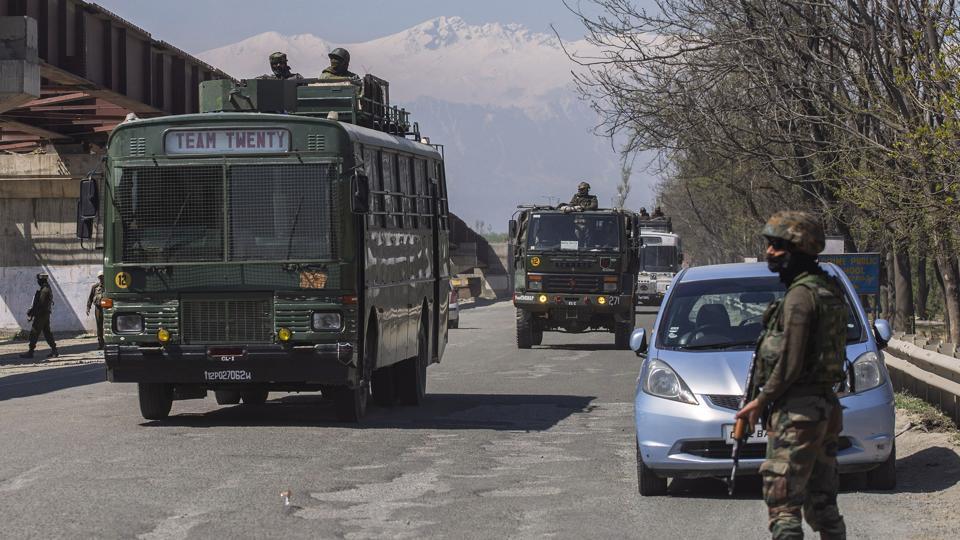 An army convoy moves on Srinagar- Jammu national highway on the outskirts of Srinagar.