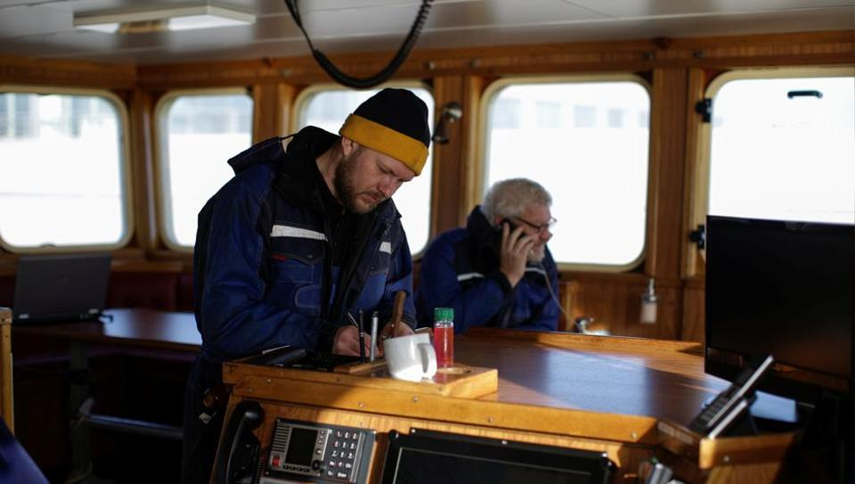 Poul Erik Rom, 35, and his father Ejvind, 65, are from a long line of fishermen. Each year they land fish worth some 25 million Danish Crowns ($3.75 million) from their vessel, one third of which come from British waters. Poul Erik began his career in the offshore oil industry, but in 2011 he bought into a fishing vessel made by his father, who has been a fisherman all his life. (Andrew Kelly / REUTERS)