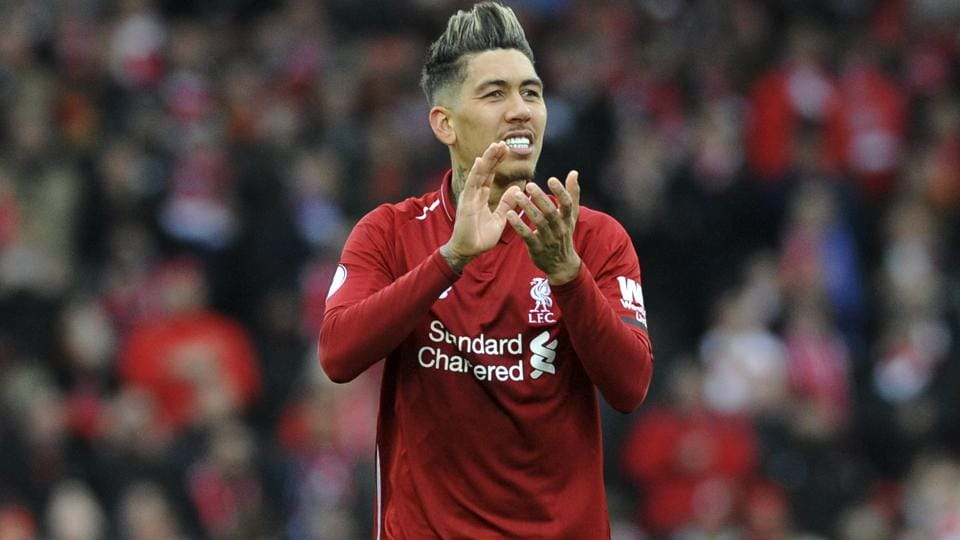 Liverpool's Roberto Firmino applauds to supporters at the end of the English Premier League match.