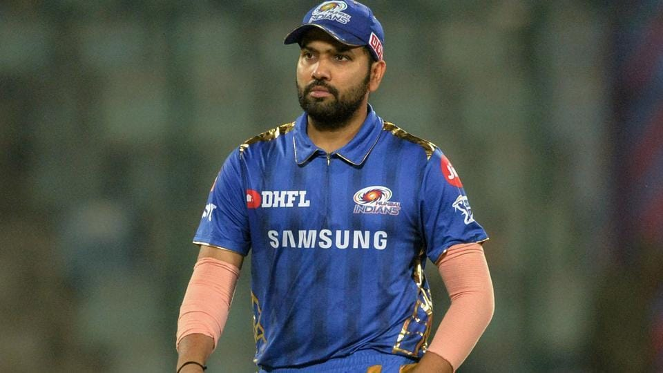 Mumbai Indians cricketerand team captain Rohit Sharma walks back after winning the 2019 Indian Premier League (IPL) Twenty20 cricket match between Delhi Capitals and Mumbai Indians at the Feroz Shah Kotla cricket stadium in New Delhi on April 18, 2019.