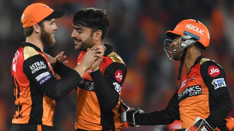 Sunrisers Hyderabad cricketer Rashid Khan (C) celebrates with his captain Kane Williamson (L).