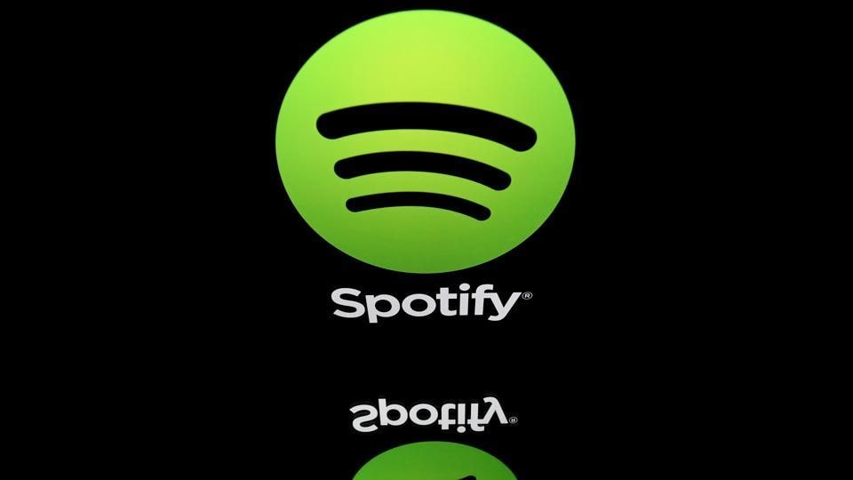 Spotify said it had amassed 100 million paying subscribers, but the company also fell back into the red and reported a first quarter operating loss.