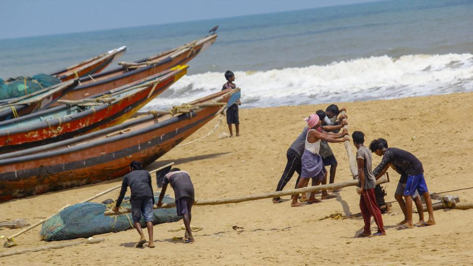 Fishermen anchor their boats after they were advised not to venture into the sea in the view of cyclonic storm 'Fani', at Puri beach, Tuesday, April 30, 2019.
