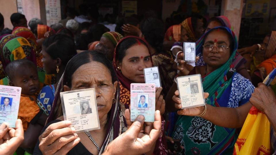 Odisha, India-April 29, 2019: Voters show their voter's identity cards as they wait to cast their votes during the 4th phase of Lok Sabha elections at a polling station , in Kendrapara district, Odisha, India, on Monday, April 29, 2019. (Photo by Arabinda Mahapatra / Hindustan Times)