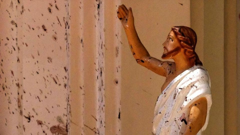 Blood stains are seen on the wall and on a Jesus Christ statue at the St. Sebastian's Church after a blast in Negombo, north of Colombo, Sri Lanka. Nearly a week later, even after the cleaners have come through, the blood can still be seen clearly. The statues of Jesus and the saints are still speckled with fragments of shrapnel. The smell of death is everywhere, though the bodies are long gone. (AP)
