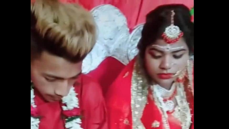 The viral video shows the groom completely engrossed in the game.
