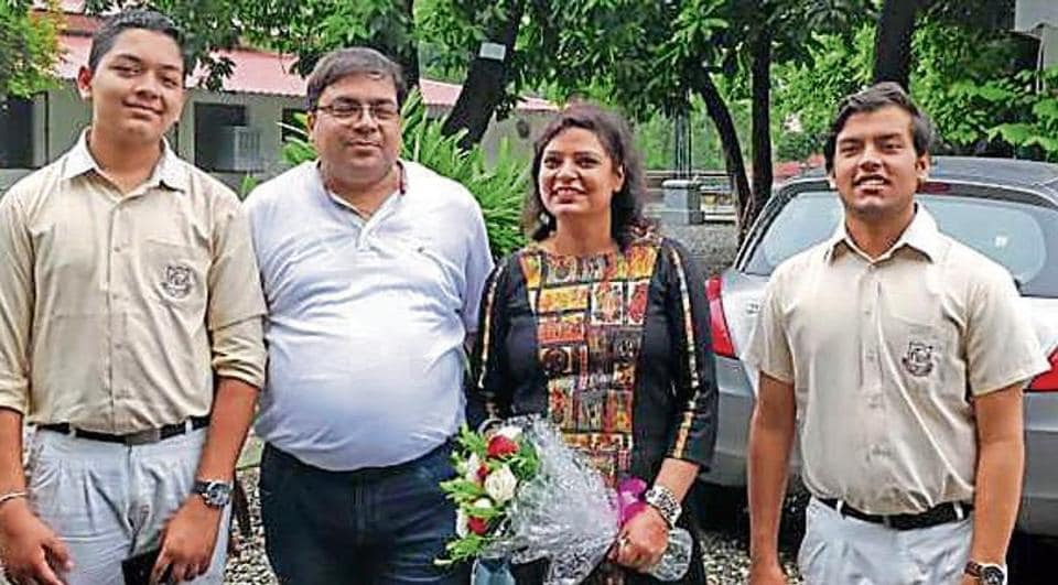 Prateek Tibrewal (right) with his family in Dehradun on Tuesday.