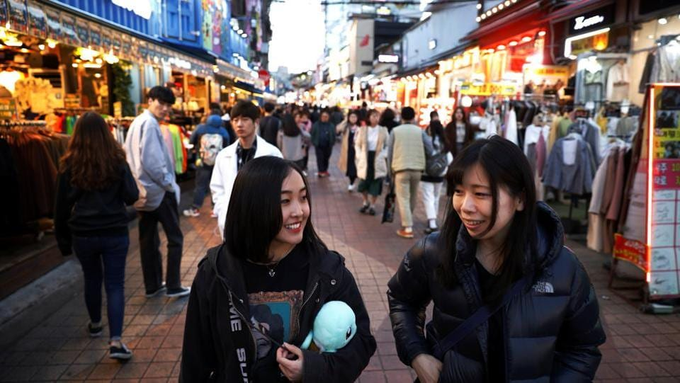 Yuuka Hasumi walks with a manager of Acopia School in the Hongdae area. Hasumi is one of 500 or so young Japanese who join Acopia each year, paying up to $3,000 a month for training and board. (Kim Hong-Ji / REUTERS)