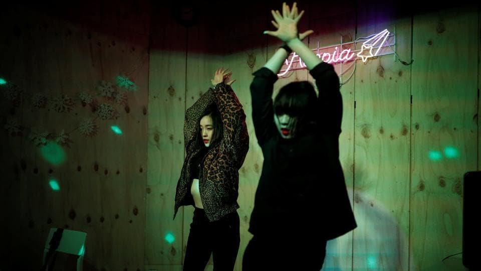 Yuuka Hasumi and Ibuki Ito, also from Japan, perform at an Acopia School party in Seoul, South Korea. Hasumi, 17, joined Acopia School in Seoul, a prep school offering young Japanese a shot at K-pop stardom, teaching them the dance moves, the songs and also the language. (Kim Hong-Ji / REUTERS)