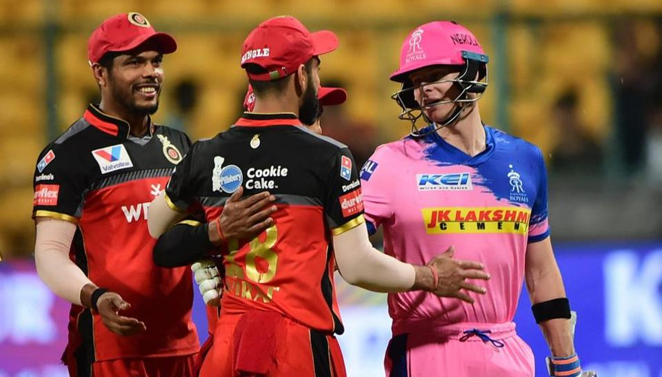 Bengaluru: RR. Batsman Steve Smith shakes hand with RCB Skipper Virat Kohli after the match was called off due to rain during the Indian Premier League 2019 (IPL T20) cricket match between Royal Challengers Bangalore (RCB) and Rajasthan Royals (RR)