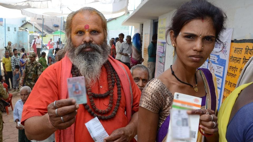 Voters queue up to cast their vote at a polling station in Madhya Pradesh.