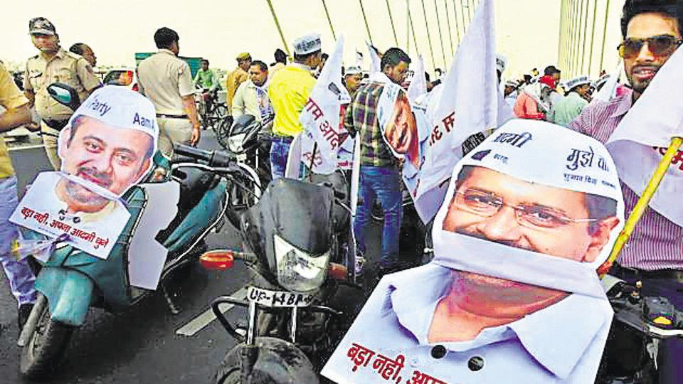 Aam Aadmi Party (AAP) supporters seen with placards during a road show in  New Delhi,on Monday, April 22, 2019.