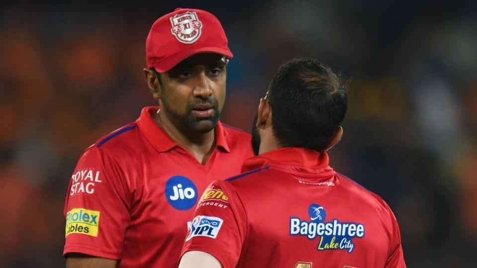 Kings XI Punjab cricket captain Ravichandran Ashwin (L) talks with Mohammed Shami.