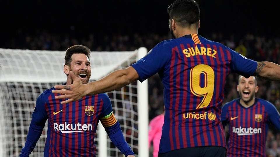 Barcelona's Argentinian forward Lionel Messi celebrates with Barcelona's Uruguayan forward Luis Suarez (R) after scoring a goal during the UEFA Champions League semi-final first leg football match between Barcelona and Liverpool