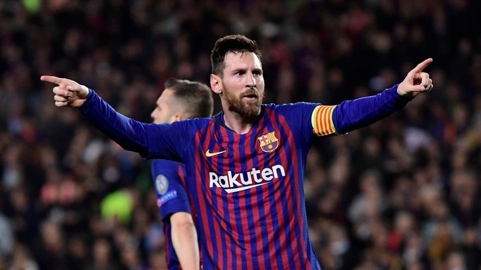 Barcelona's Argentinian forward Lionel Messi celebrates after scoring his team's third goal during the UEFA Champions League semi-final first leg football match between Barcelona and Liverpool at the Camp Nou Stadium in Barcelona on May 1, 2019