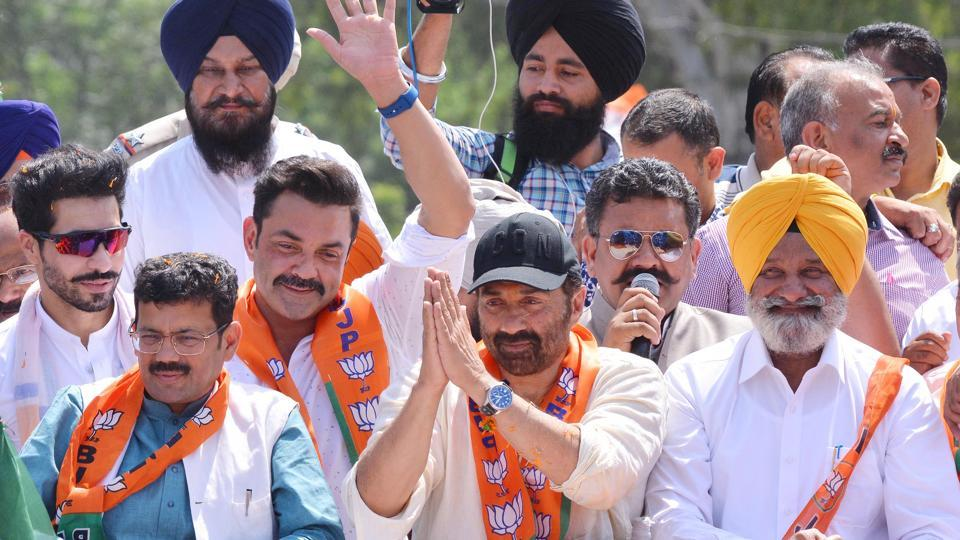 Bharatiya Janata Party candidate from Gurdaspur Lok Sabha constituency Sunny Deol with his brother Bobby Deol and SAD-BJP leaders during a road show in Gurdaspur on Thursday.