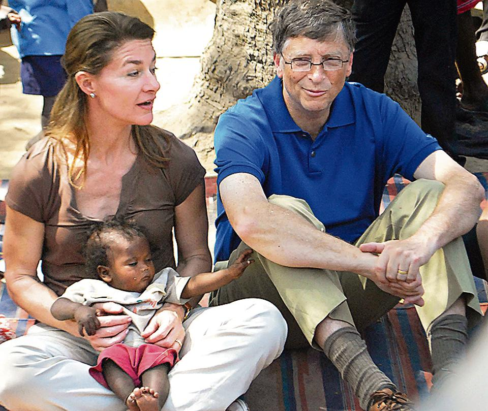Melinda Gates and her husband Bill with a toddler during a visit to Bihar in March 2011.