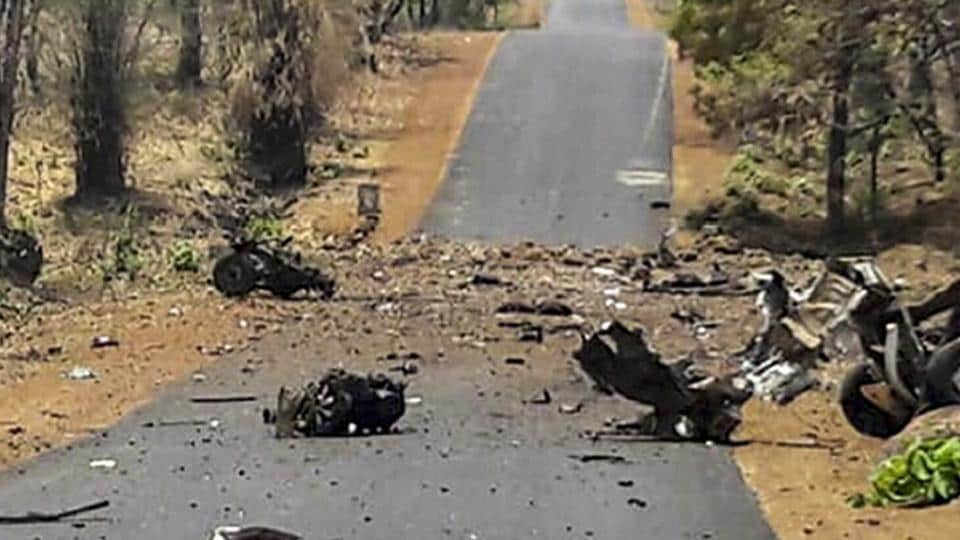 Mangled remains of a police vehicle, carrying 16 security personnel that was allegedly blasted by Maoists using IED, in Gadchiroli, Wednesday