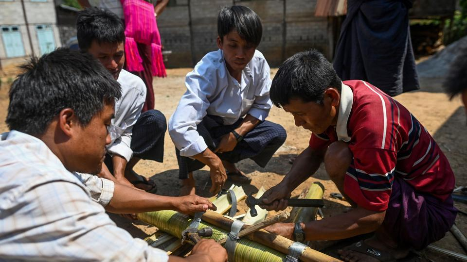 In the past, these rockets were crafted entirely from bamboo and would carry up to 40 kilos of explosives. Now they are made with bamboo-wrapped metal, holding five different grades of gunpowder. (Ye Aung Thu / AFP)