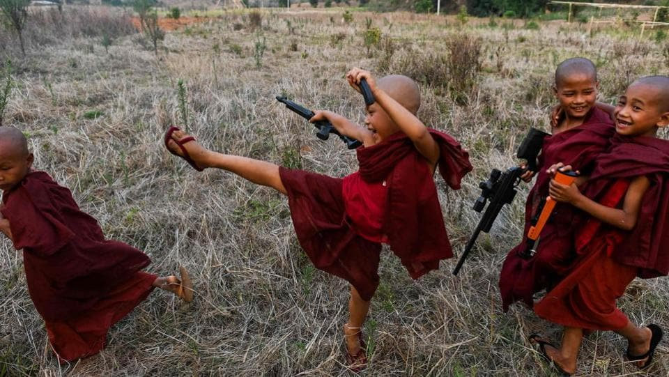 Buddhist novices play with toy guns during the rocket festival in Nantar. As the sun set and the rockets fell silent, the next generation in training took over. Groups of boys set off fireworks to squeals of delight and fired toy guns into the air in celebration. (Ye Aung Thu / AFP)