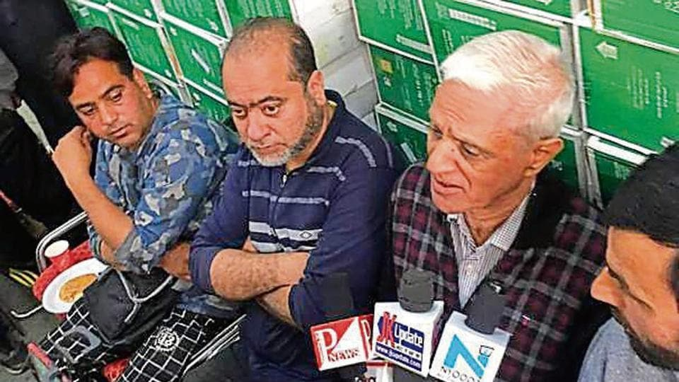 Roshan Lal Mewa after reopening his shop at Zainakadal — a commercial hub — in Srinagar on Wednesday.