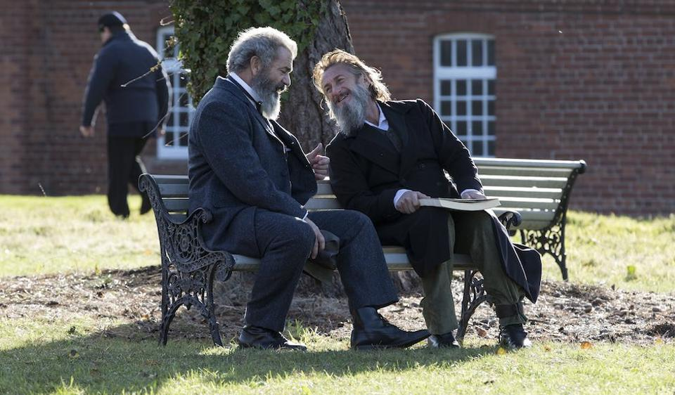 Mel Gibson and Sean Penn in a still from The Professor and the Madman. Gibson plays the former schoolteacher who edited the first edition; Penn is the mentally unstable former army surgeon who helped him put it together.