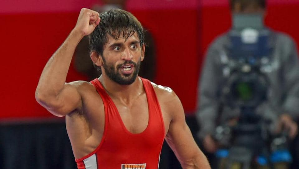 Jakarta: India's Bajrang Punia gestures after winning in the Finals of men's freestyle wrestling (65kg) against Japan's Daichi Takatani at the Asian Games 2018, in Jakarta on Sunday, August 19, 2018. (PTI Photo/Shahbaz Khan) (PTI8_19_2018_000214B)