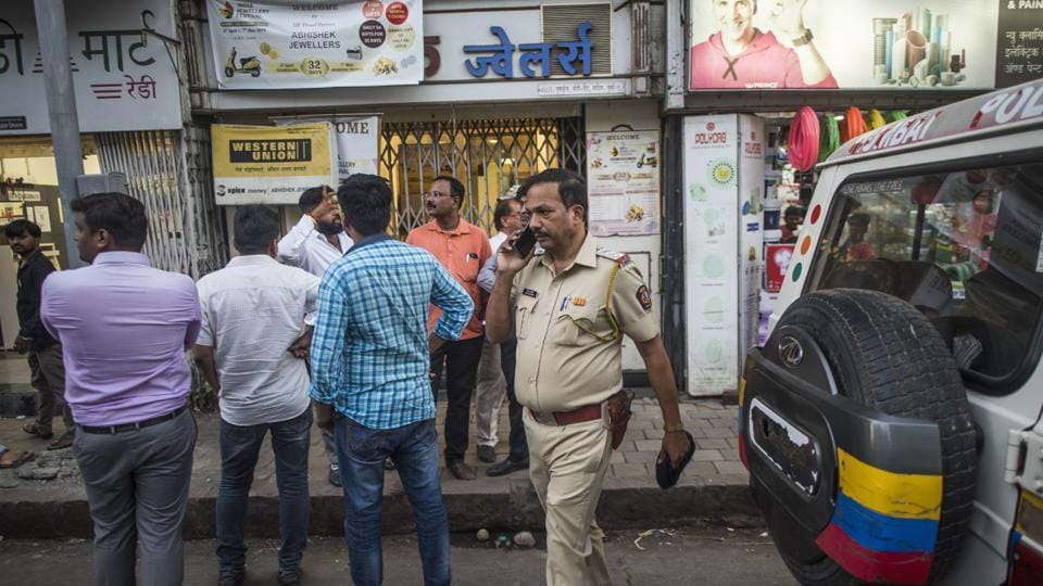 Police personnel at the scene of the robbery in Mumbai on Thursday.