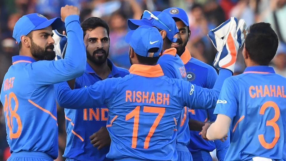 India cricketer Bhuvneshwar Kumar (2L) celebrates the wicket of Australia cricket captain Aaron Finch with captain Virat Kohli (L) and teammates during the fourth one-day international (ODI) cricket match between India and Australia at the Punjab Cricket Association Stadium in Mohali on March 10, 2019.