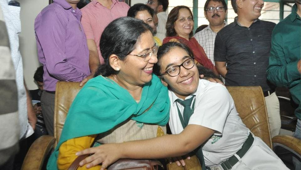 Hansika Shukla and her mother after the declaration of CBSE's class XII results, in Ghaziabad, India, on Thursday