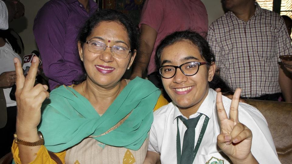 Ghaziabad: Hansika Shukla, CBSE class 12th topper, poses for a photograph with her mother after the results were declared, in Ghaziabad, Thursday, May 02, 2019. Shukla scored 499 out of 500 marks. (PTI Photo)(PTI5_2_2019_000037B)
