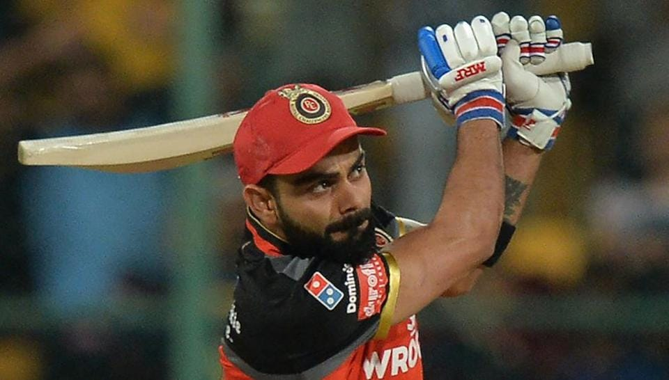 Royal Challengers Bangalore captain and batsman Virat Kohli plays a shot during the 2019 Indian Premier League (IPL) Twenty20 cricket match between Royal Challengers Bangalore and Rajasthan Royals at The M. Chinnaswamy Stadium in Bangalore on April 30, 2019.