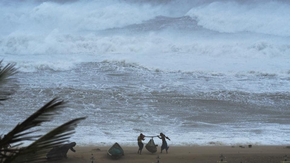Fishermen seen during high tide owing to cyclone Fani, at Puri beach, in Odisha. Fani is India's strongest summertime cyclone in the last 43 years.The government has evacuated more than a million people from districts likely to be affected by it. (Arabinda Mahapatra / HT Photo)
