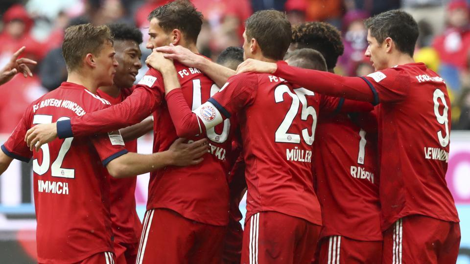 Bayern's players celebrate after scoring their side's third goal.