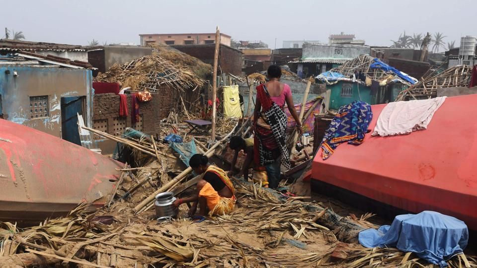 People look through the debris next to storm-damaged buildings in Puri after it was hit by cyclone Fani. The Odisha government is now on the task of restoring infrastructure afresh in Puri district and parts of Khurda, which is severally ruined. The districts of Cuttack, Bhadrak, Kendrapada, Jagatsinghpur, Balasore, Mayurbhanj, Keonjhar, Dhenkanal, Nayagada have also been affected. (Dibyangshu Sarkar / AFP)
