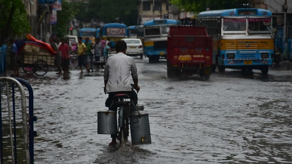 Vehicles move slowly in a flooded road in Kolkata on Saturday in the aftermath of  cyclone Fani.