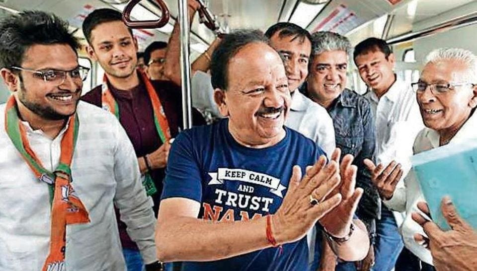 BJP candidate from Chandni Chowk Harsh Vardhan greets commuters during his Metro ride on Saturday.